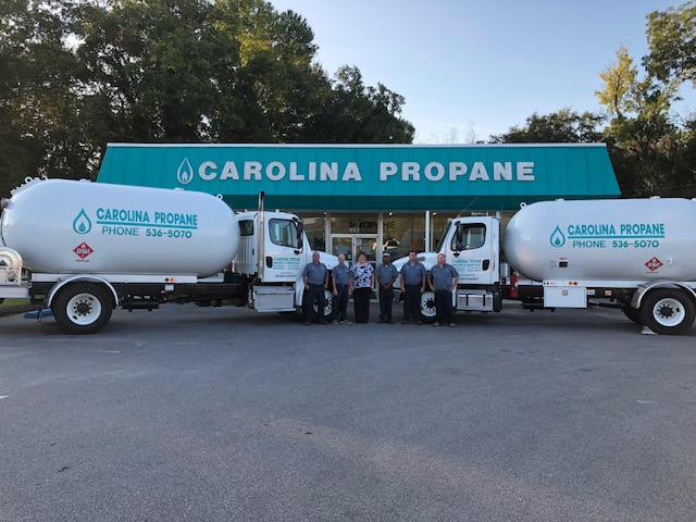 Propane trucks and drivers in front of Carolina Propane office